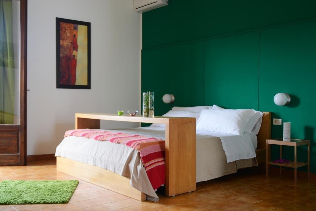 Hotel Kaucana Inn - slaapkamer
