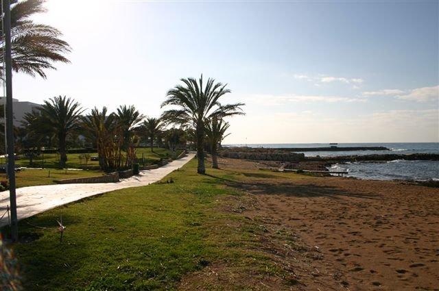 Hotel Athena Beach - tuin en strand