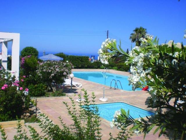 Appartementen Muses - zwembad in tuin
